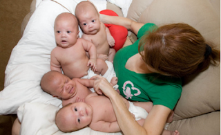 Dad quits breast milk diet, donates stash to quadruplets
