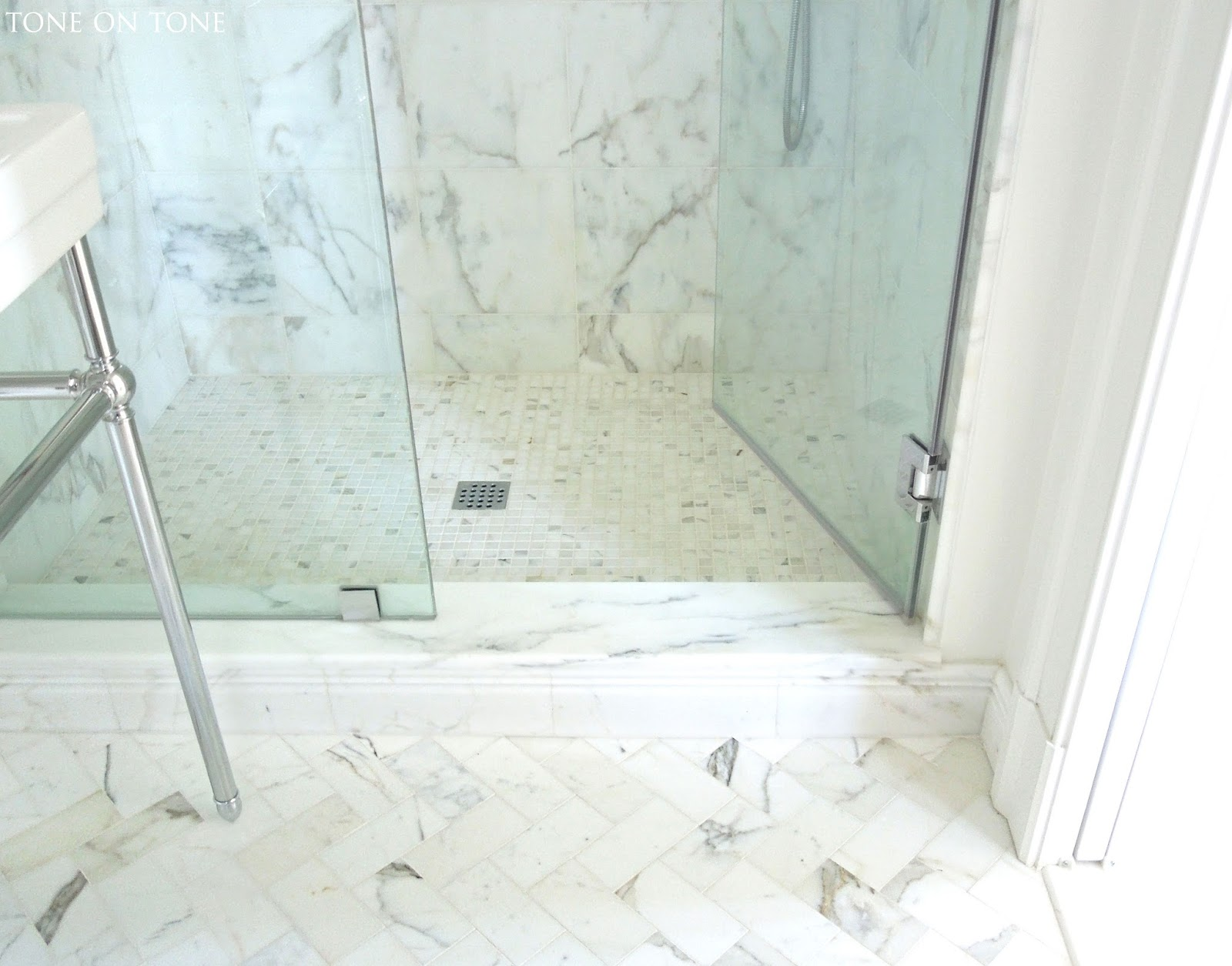 Tone on tone for Marble bathroom bin