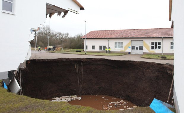What came out of here? Huge sinkhole swallows buildings in Norhausen, Germany