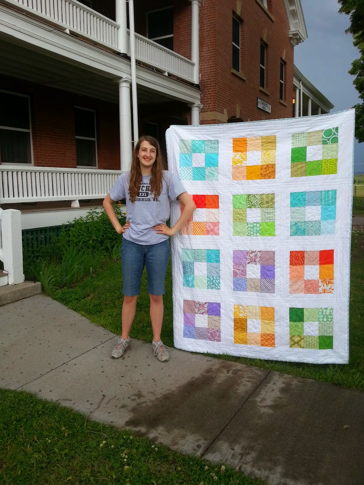 Brightly Colored Charm Square Quilt