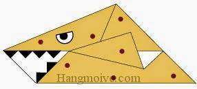 Bước 7: Vẽ mắt, răng để hoàn thành cách xếp con thằn lằn biển Kronosaurus bằng giấy origami đơn giản.