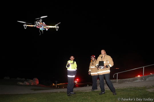 Firefighters got to try out a UAV Unmanned aerial vehicle - camera drone - which has been in the Bay for the last three days - Late night fire on Te Mata Peak, on the face nearest Craggy Range Winery, just down from the hang-glider, paraglider launching pad at the top. photograph