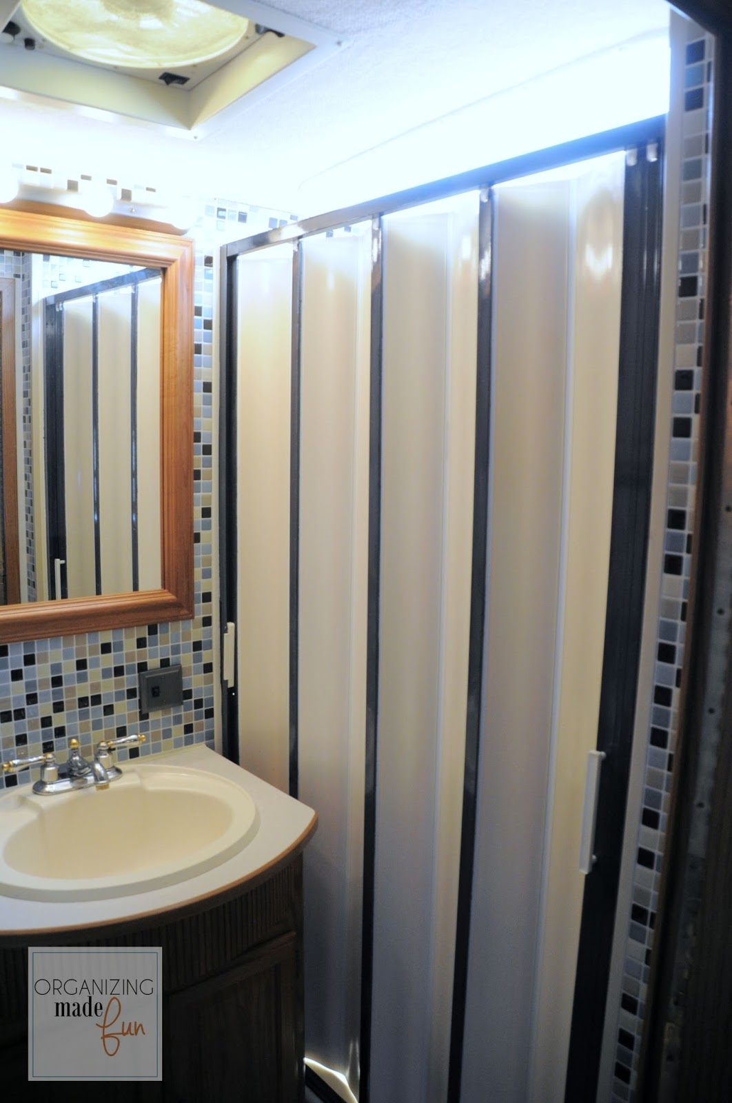 Popular RV bathroom with updated shower in oil rubbed bronze OrganizingMadeFun