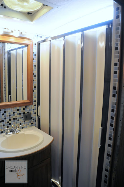 RV bathroom with updated shower in oil rubbed bronze :: OrganizingMadeFun.com