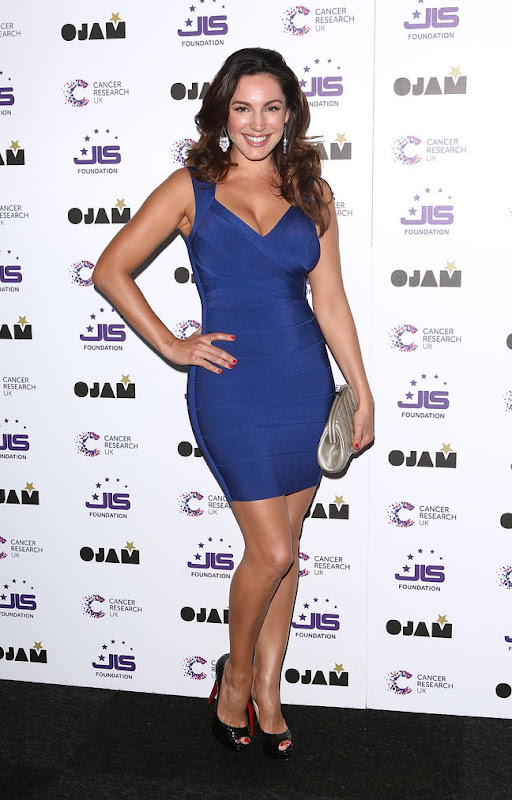 Kelly Brook wearing a skintight blue dress