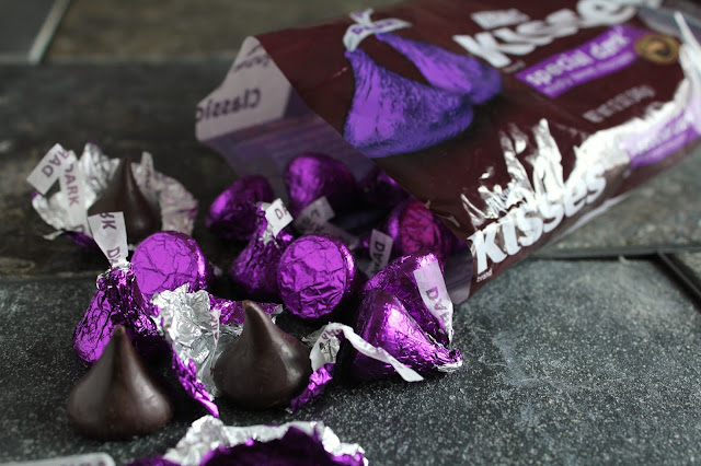 unwrapping special dark Hershey's kisses