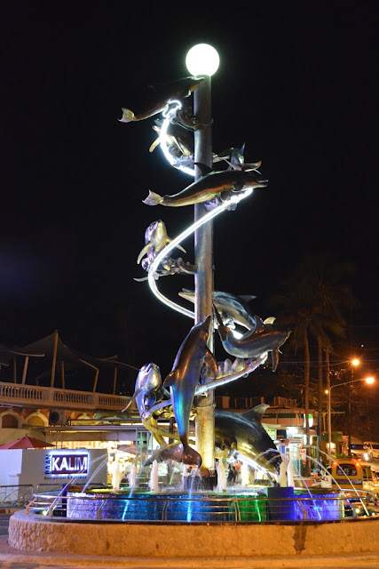 Patong Beach by night dolphins