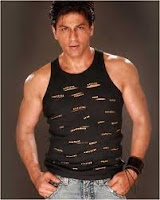 Shah Rukh Khan posing with muscle shirt