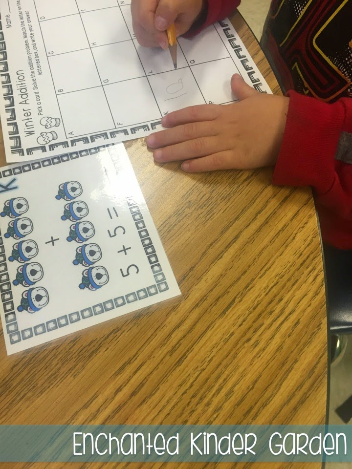 This is a photograph of a kindergarten math task card activity.
