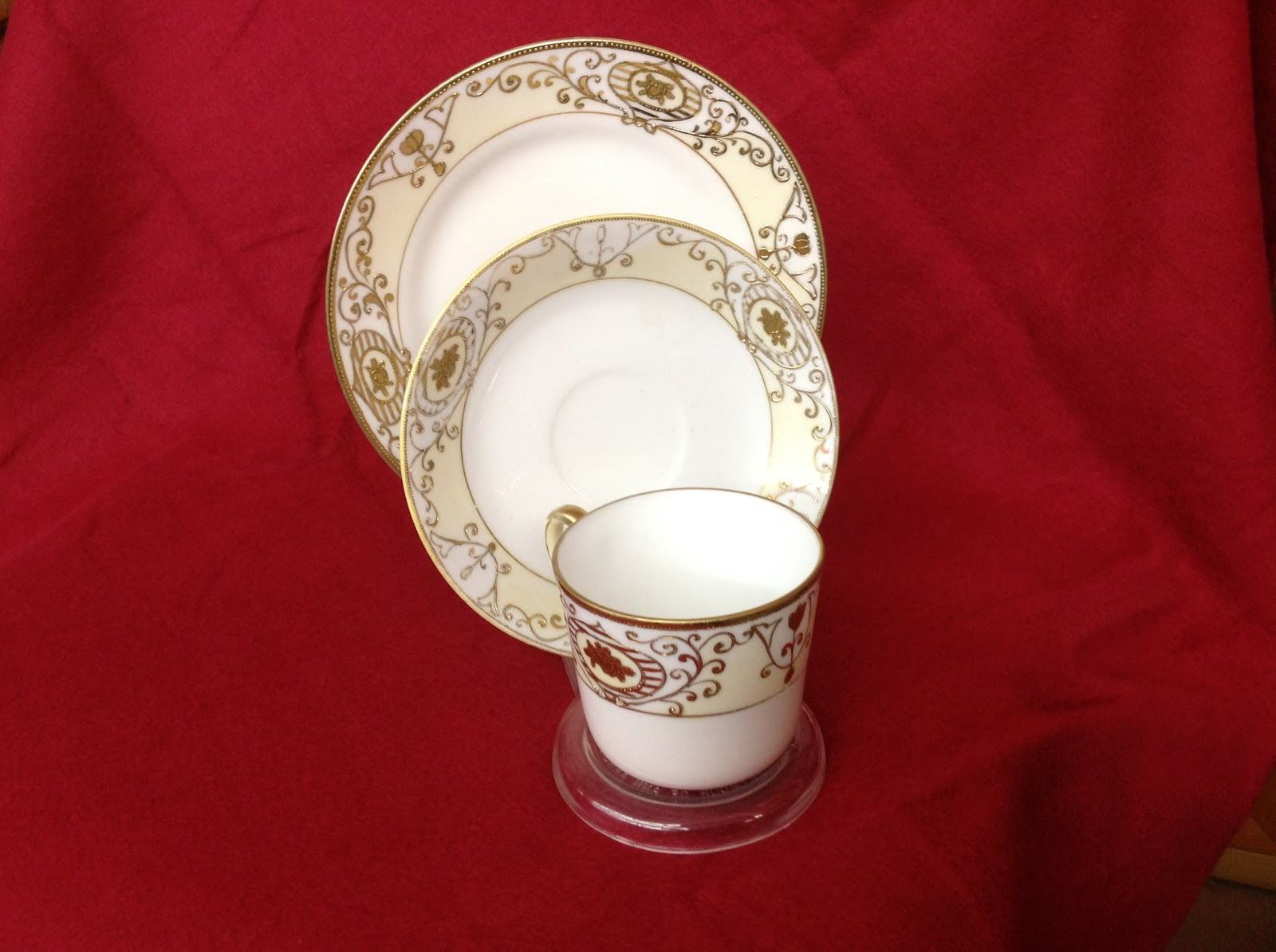 gold and cream embossed Noritake cup, saucer and plate set