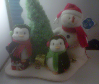 penguins and snowman caroling