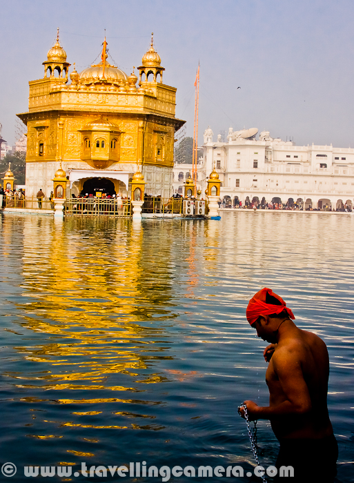 This photograph is clicked on 1st Jan, 2012. This Boy was having holy bath at Golden Temple on a chilling morning with mist all around.There were lot of folks from various parts of Punjab and surrounding states at Golden Temple. I have been to this place many times, but this time it was too much crowded and there was hardly some space to freely move around. Everyone wanted to start the New Year with God's blessing.