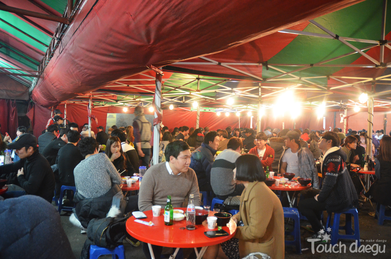 The tent is filled with people who have Bulgogi & Udon