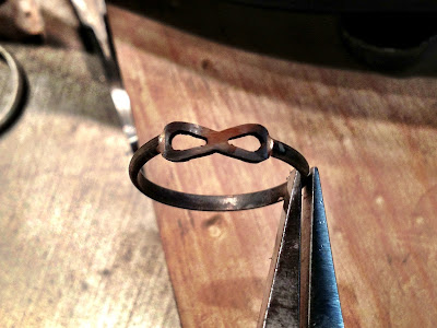 Photo taken after soldering infinity piece to ring portion.