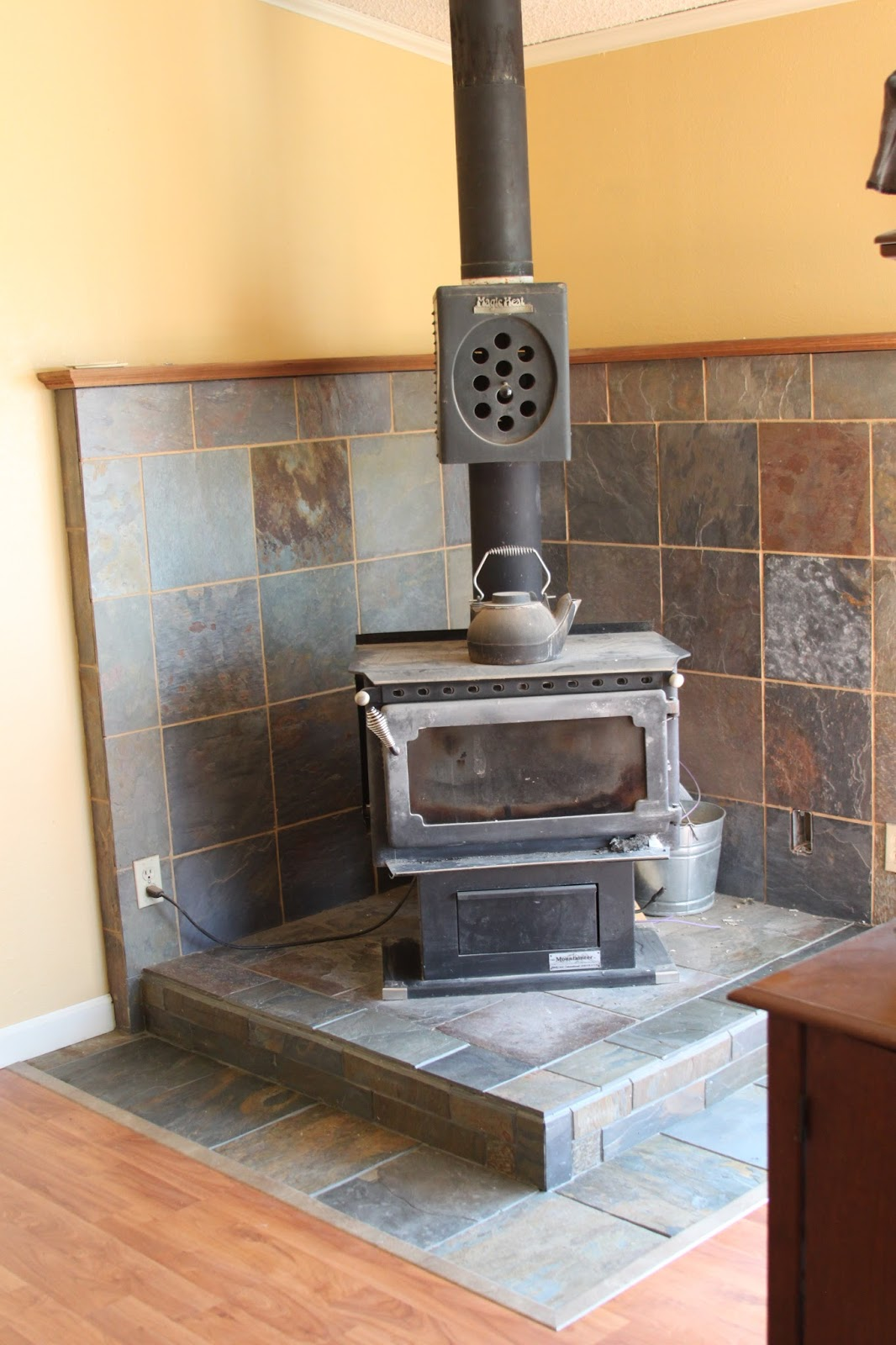 I found that the transition piece that looked the best between the tile and  the flooring was a laminate marbled brown. It was not inexpensive, costing  much ... - Li'l Buck's Creations: Wood Stove Slate Tile Surround