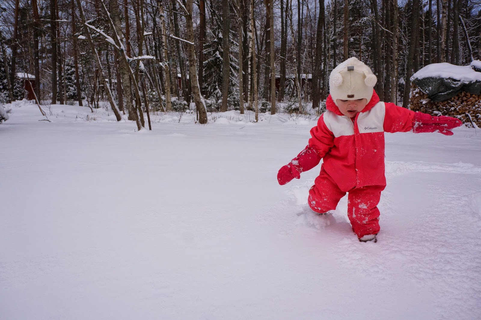 toddler wading in snow