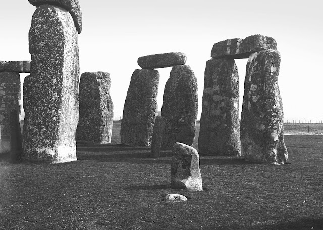 Stonehenge, Amesbury. Looking E. 35 degrees N. Stonehenge. Outer Circle from within and Inner Circle of foreign stones represented by the stump and two erect masses of dolerite. To the left is one of the intact trilithons, and one of the dolerites of the Inner Horseshoe.