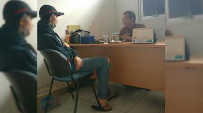Foto Putty Revina saat diperiksa polisi