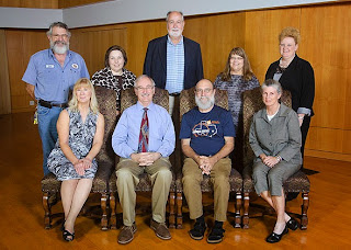 Dr.Dennis Longmire, seated, second from left, has taught at the College for 30 years.