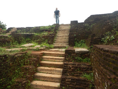 No evidences of palace ruins, stairs, terraces, ramped ledges, red bricks, narrow footsteps, Sigiriya summit