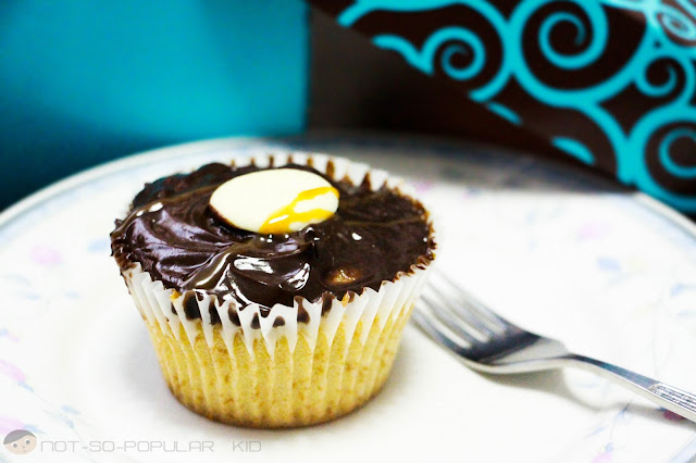Sweet Maria's Vanilla/White Cupcake Topped with Chocolate Ganache