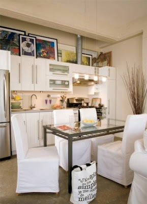 mylittlehousedesign.com leaning framed art above cabinets