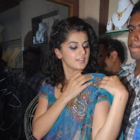 glorious and beloved Tapsee hot stills in blue transparent saree