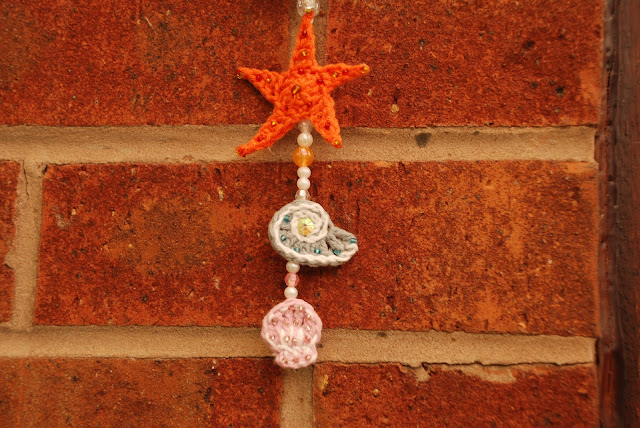 image of crocheted starfish and shells