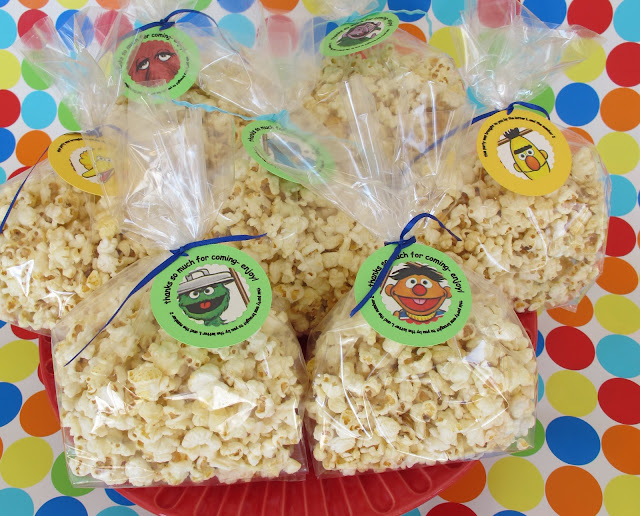 Since there were both kids and adults coming this party, I wanted to have favors that both would like. I found these adorable jars filled with playdough from Miss Nibbit for the kids, and filled cellophane bags with organic kettle corn.