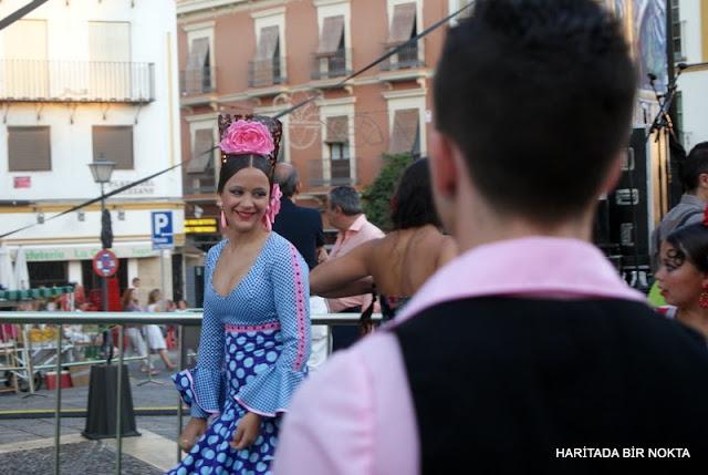 a woman in flamenco dress seville spain