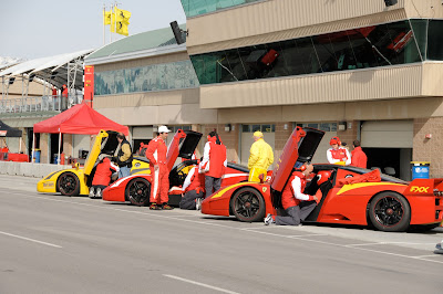 Yellow and Red Ferrari FXX's all lined up - race preparation