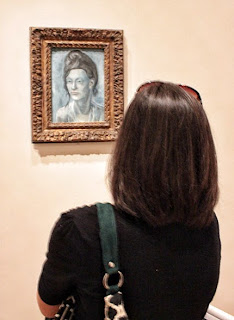 "Photograph of Picasso's painting ""Woman with a Helmet of Hair Paris, 1904."""
