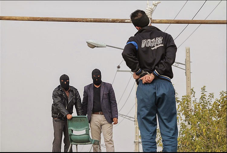 Darkness at noon: Public execution in Iran (file photo)