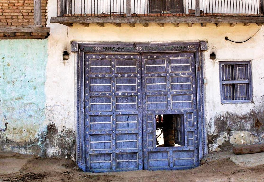 Exotic wooden doors from a gujarati village for Door design kashmir