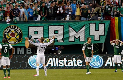 LA Galaxy player David Beckham celebrates after scoring his first goal against Portland Timbers