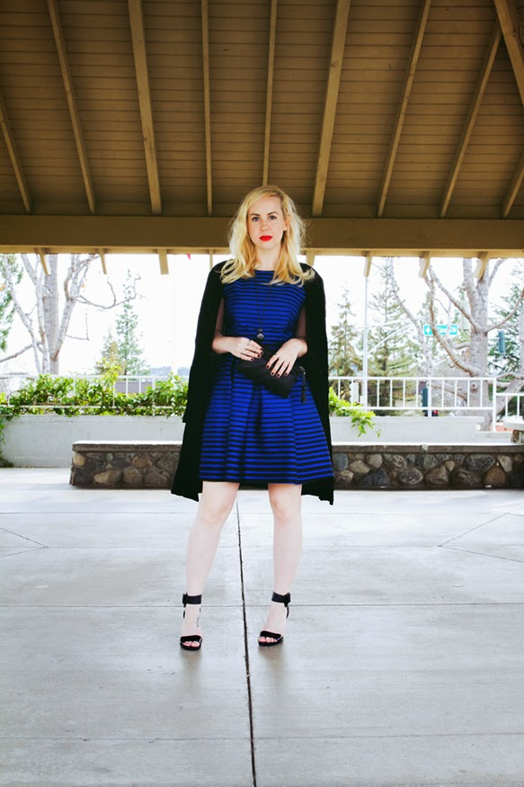 red lips and black and blue stripes
