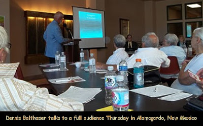 Dennis Balthaser talks to a full audience Thursday in Alamogordo