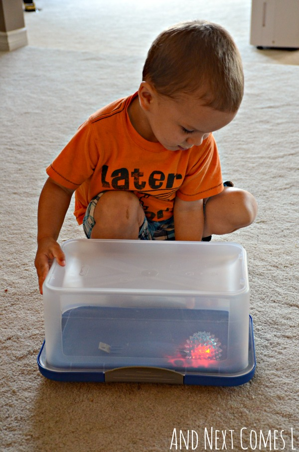 Gross motor boredom buster: playing with a glow ball in a box from And Next Comes L