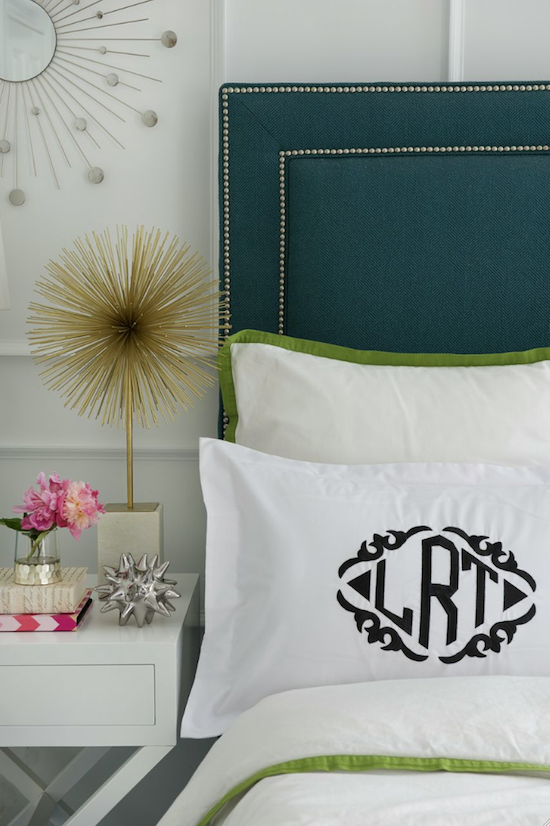 monogram pillow sham, nailhead upholstered headboard, starburst statue, urchin