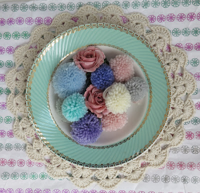 pompons, pastel, thrifted, plate, paper, crochet