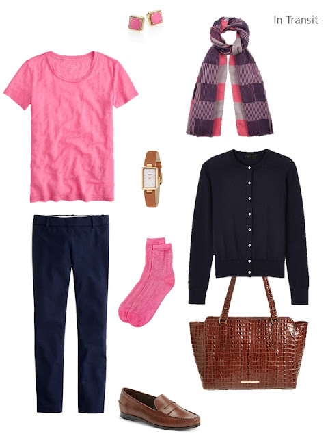 a navy and pink travel outfit with brown leather accessories