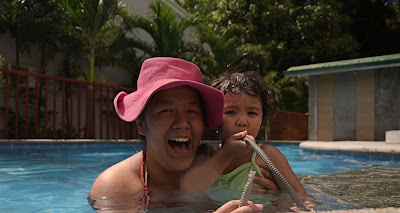 Mama and Kecil at the swimming pool