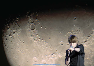 Wallpaper of Justin Bieber in Concert at Moon Light Radiance wallpaper for the fans
