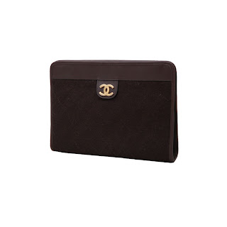"""Vintage 1970's dark brown quilted Chanel clutch with gold """"CC"""" hardware."""