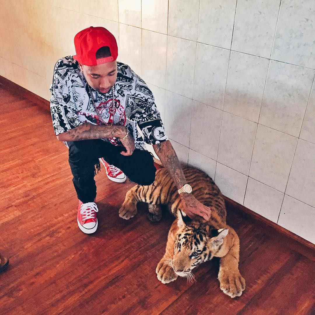 WTH? Check Out This Picture Of Tyga With A Tiger And A Stack Of Money