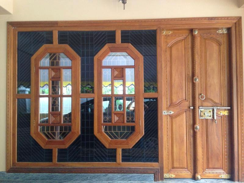 Kerala style carpenter works and designs kerala style for Wooden window design with glass