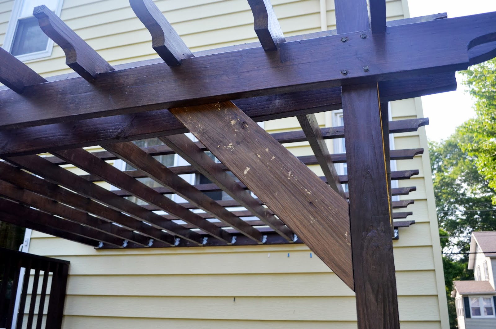 In The Little Yellow House Pergola Braces