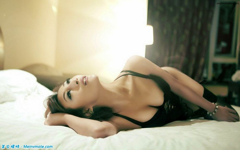 Bed heaving seductive beauty of loneliness