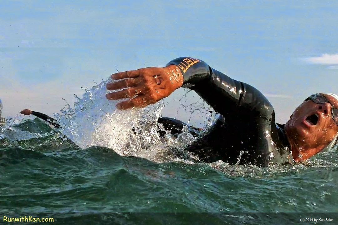 Up-close action photo of triathlete beaching like a whale while open water swimming at the Marshfield-Duxbury Triathlon. Photography from Inside the Pack by Ken Skier, the Swimming Photographer. (RunwithKen.com)