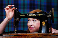 Rowan demonstrating the Singer Sewing Machine at the launch in Glasgow